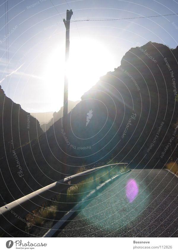 Sun Street Lanes & trails Traffic infrastructure Electricity pylon Tar Telegraph pole Country road Crash barrier