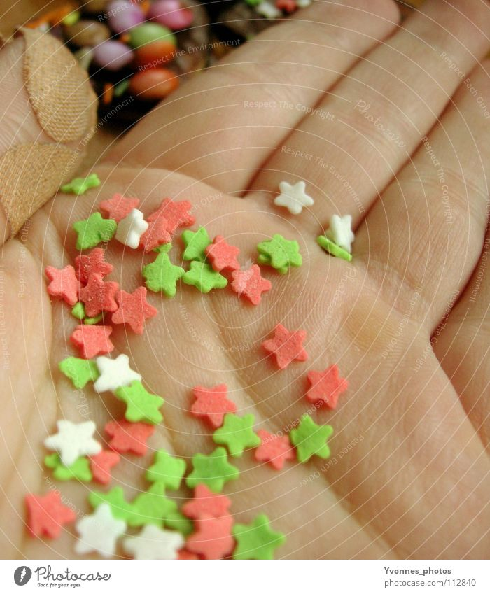 In the cookies, ready, go! Palm of the hand Star (Symbol) Craft materials Close-up Partially visible Section of image Detail Diminutive Small Many