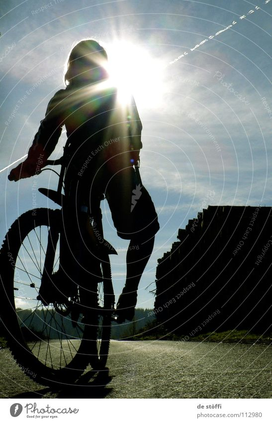 A SPARK OF JOY Mountain bike Autumn Sunbeam Dark Vacation & Travel In transit Tracks Bicycle Heavenly Funsport Silhouette biking Contrast Street Blue sky Action