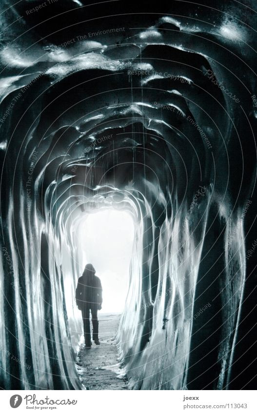 Tunnel into the light Nightmare Way out Narrow Dark Entrance Loneliness Iceberg Blue Cold Frozen water Fluid Damp Freeze Glacier Glacier ice Creepy Cave Jacket