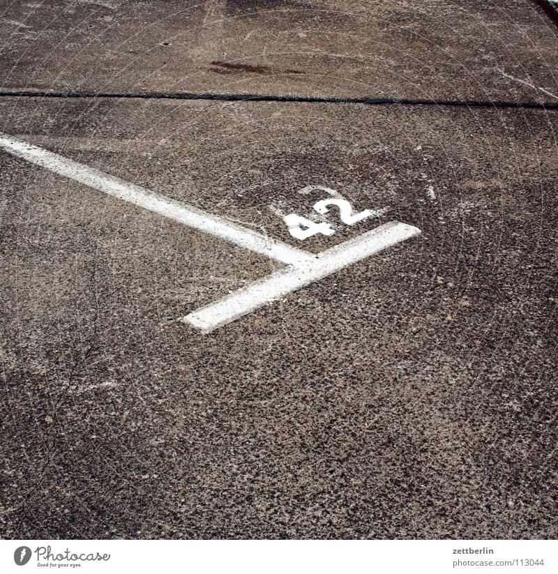 Signs and labeling Concrete Transport Corner Digits and numbers Asphalt Stripe Traffic infrastructure Parking lot Pavement Traffic lane Answer