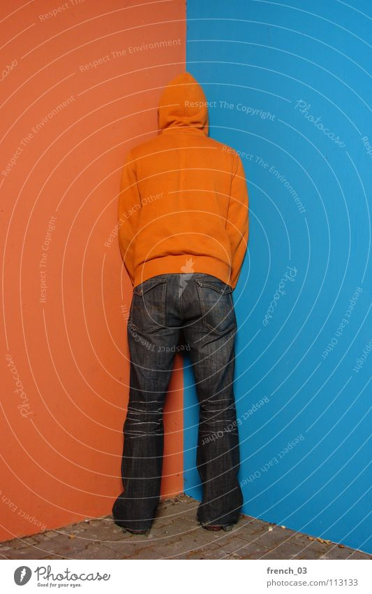 Human being Man Youth (Young adults) Blue Colour Wall (building) Gray Wall (barrier) Lake Line Orange Footwear Masculine Concrete Perspective Clothing