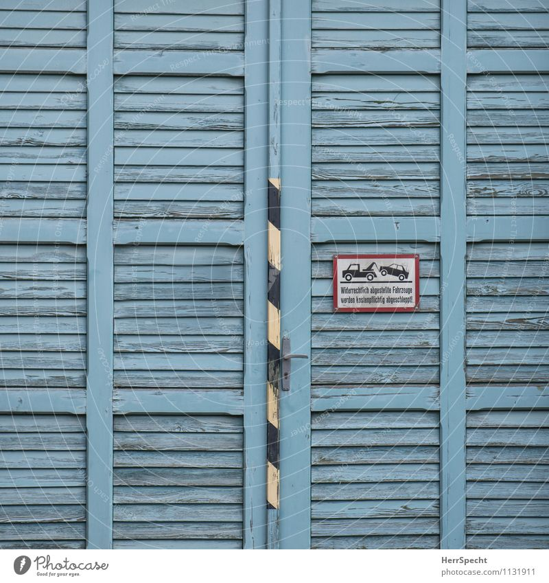 A gate (who parks here) Gate Manmade structures Building Door Road traffic Motoring Road sign Wood Characters Signage Warning sign Old Esthetic Blue Clearway