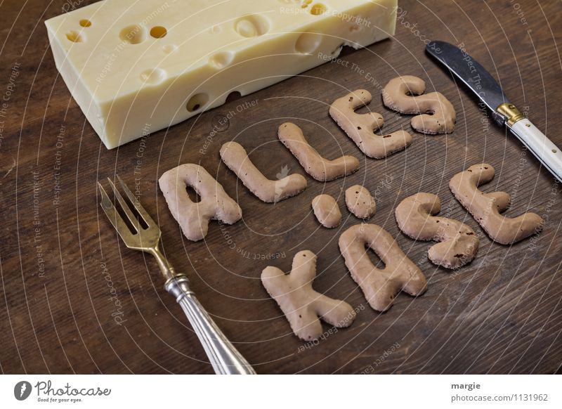 The letters ALL CHEESE on a rustic wooden board with a piece of hole - cheese and knife and fork Food Cheese Nutrition Breakfast Dinner Buffet Brunch Picnic