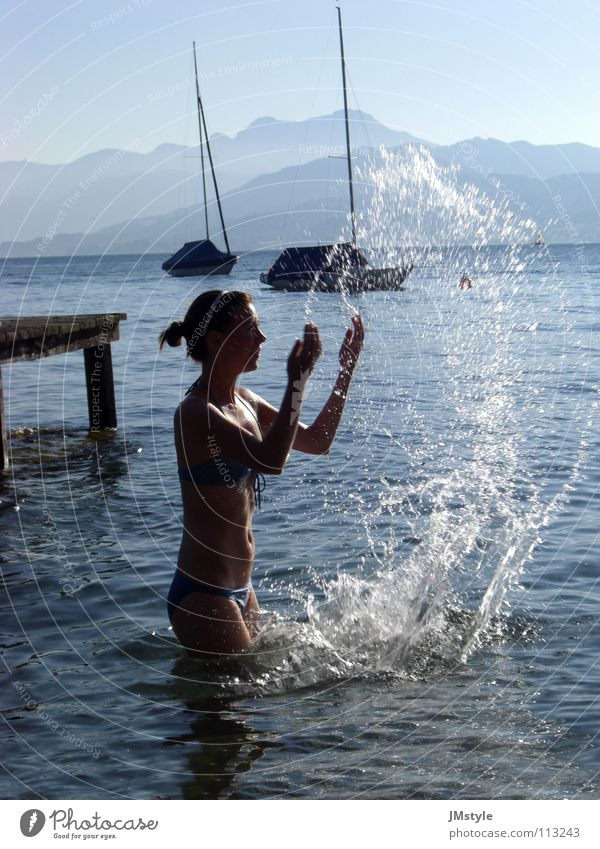 Woman Youth (Young adults) Water Playing Mountain Lake Swimming & Bathing Fog Watercraft Drops of water Footbridge Bikini Snapshot Austria Sailboat