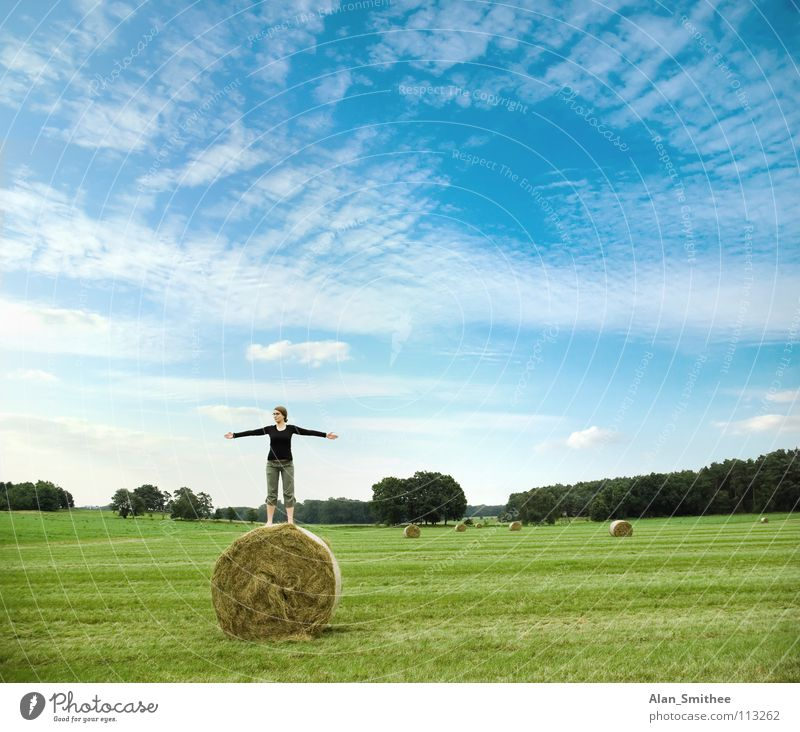 enjoying the nature Nature Meditation Blue sky Summer Jump Joy Woman meadow country side young woman bale hay green grass spread poor freedom Exterior shot