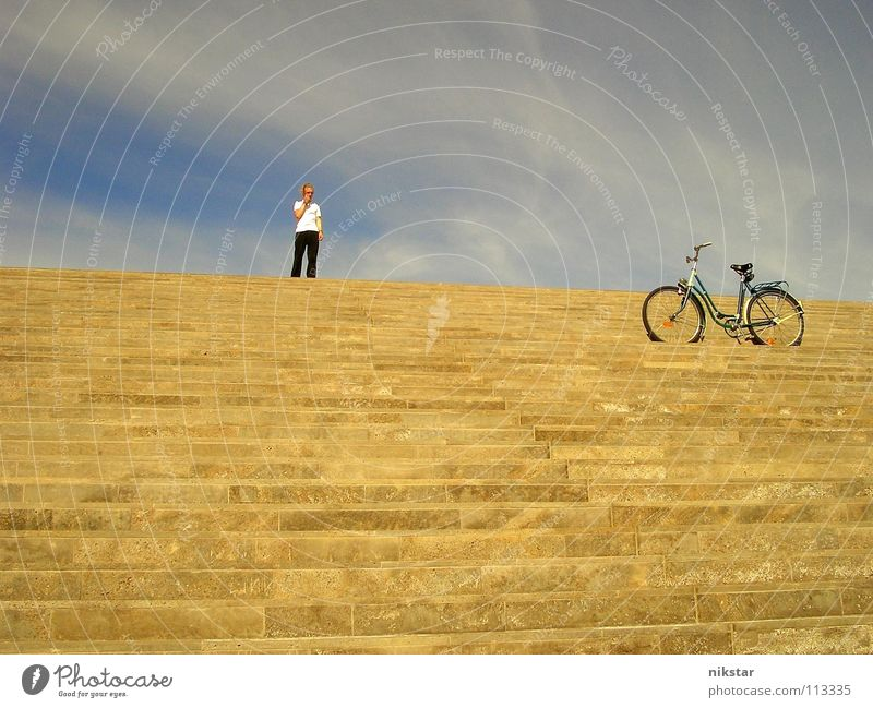 large question mark (original) Bicycle Man Clouds Yellow Gray Movement Blonde Dresden Beautiful weather Sky Stairs Human being Gold Blue Logistics