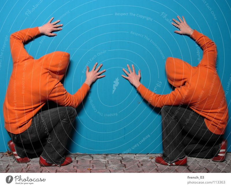 Human being Man Hand Youth (Young adults) Blue Colour Wall (building) Gray Wall (barrier) Lake Line Footwear Orange Masculine Concrete Fingers