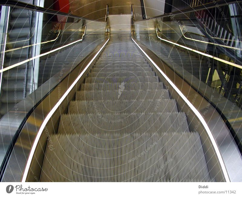escalator Escalator Above Architecture Stairs Movement as of Wasted journey Empty Deserted Central perspective Metal Downward Banister Glass Lighting