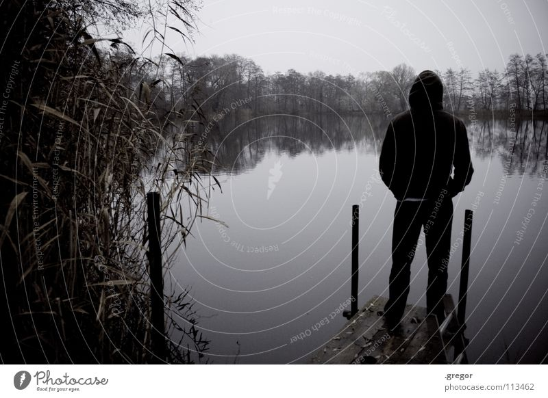 Monk by the sea Autumn Winter November Gray Bland Damp Wet Bad weather Cold Vantage point Looking Calm To be silent Listening Lake Pond Footbridge Stand Dreary