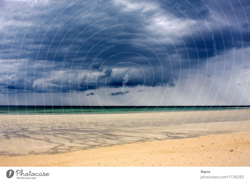 in indian ocean madagascar Sky Nature Vacation & Travel Blue Green White Ocean Clouds Beach Black Yellow Coast Stone Brown Sand Line