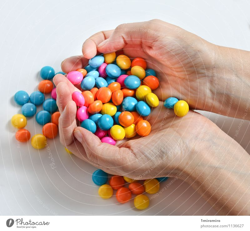 Colored candy Food Candy Hand Delicious Sweet Yellow Green White Colour colorful Confectionary Hold Snack Sugar sweets Unhealthy yummy hands Colour photo