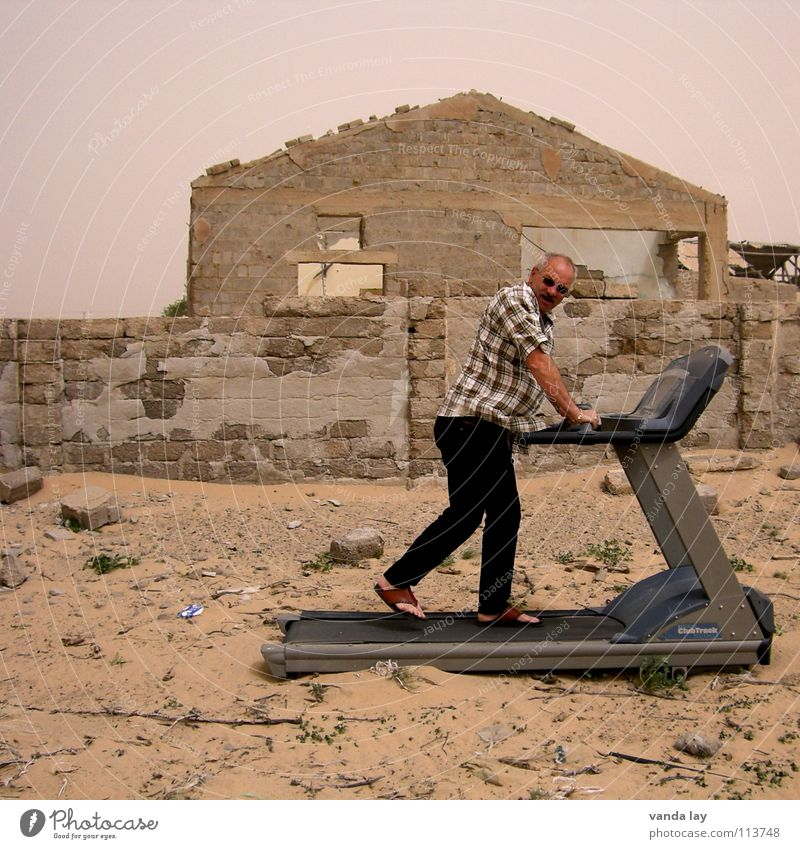 Home Trainer Moving pavement Jogging Ruin House (Residential Structure) Dry Man Sunglasses Destruction Practice Derelict Desert Dangerous Walking Sand Fitness