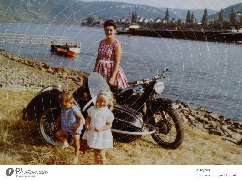 Economic Miracle Years... Motorcycle Mosel (wine-growing area) Watercraft Girl Child Mother Safety (feeling of) Dress Peace bmw sidecars Rhine River Boy (child)