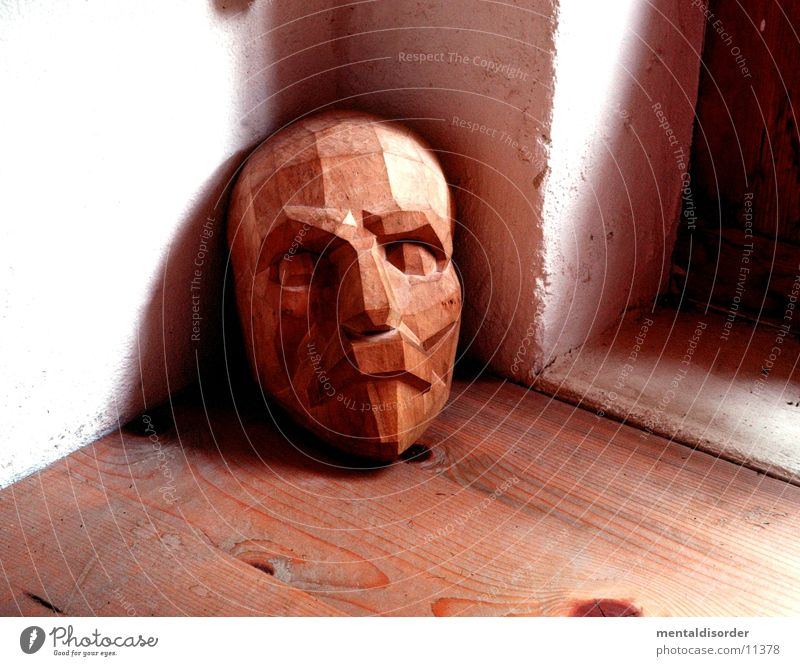 Mask made of wood Wood Brown Window White Pattern Obscure Face Corner Nature Floor covering Hallway Frame Eyes Nose Mouth Head Looking Shadow Wood grain