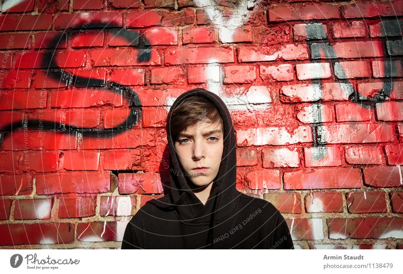 Portrait of a teenager with hoodie in front of a graffiti wall Graffiti Young man Lifestyle Style Design Human being Masculine Youth (Young adults) Head 1