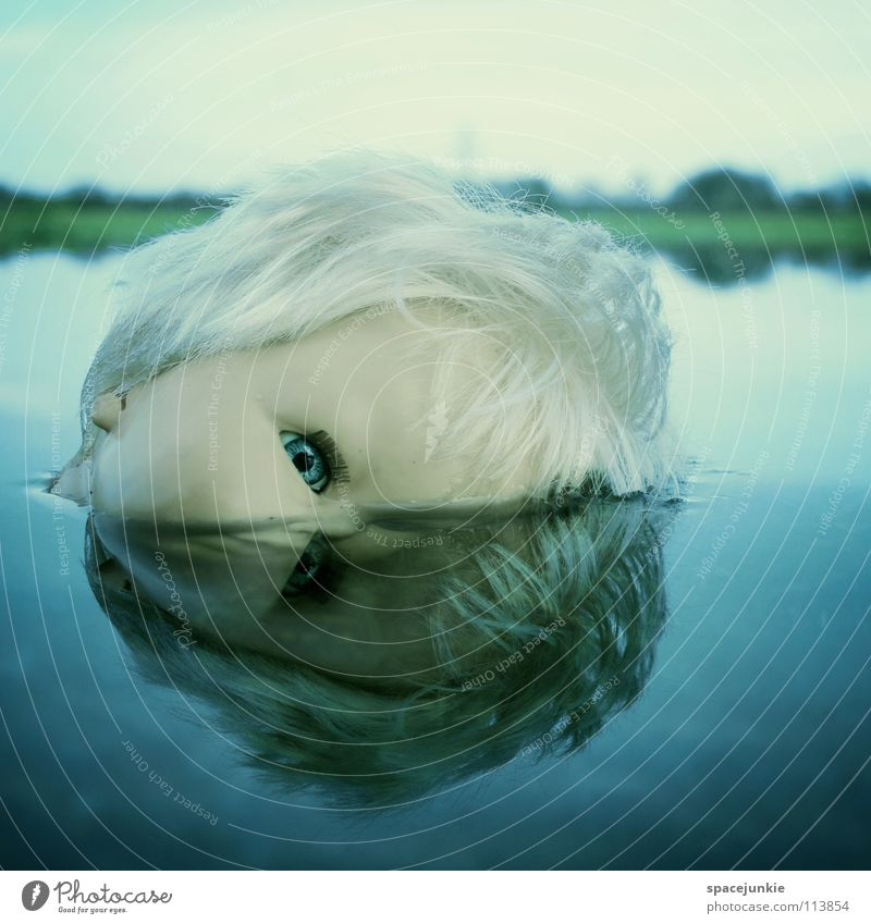 In the water (2) Toys Threat Alarming Blonde Chucky Creepy Horror film Evil Sweet Cute Whimsical Lake Ocean Wet Joy Doll Eyes Blue Fear Wild animal