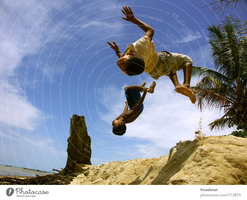 Sky Youth (Young adults) Vacation & Travel Tree Summer Ocean Beach Joy Clouds Sports Warmth Playing Freedom Happy Sand Air