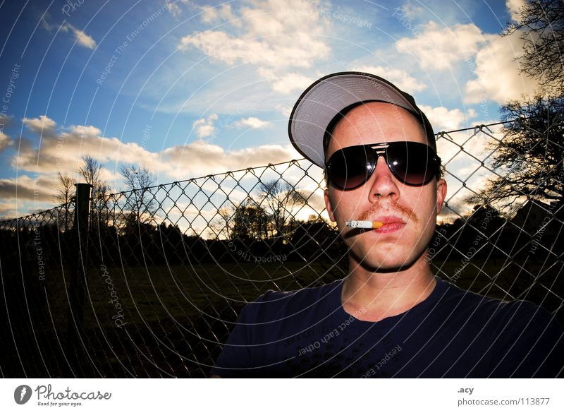 Sky Man Youth (Young adults) Sun Clouds Relaxation Garden Bright Cool (slang) Eyeglasses Smoking Serene Smoke Fence Stalk Facial hair