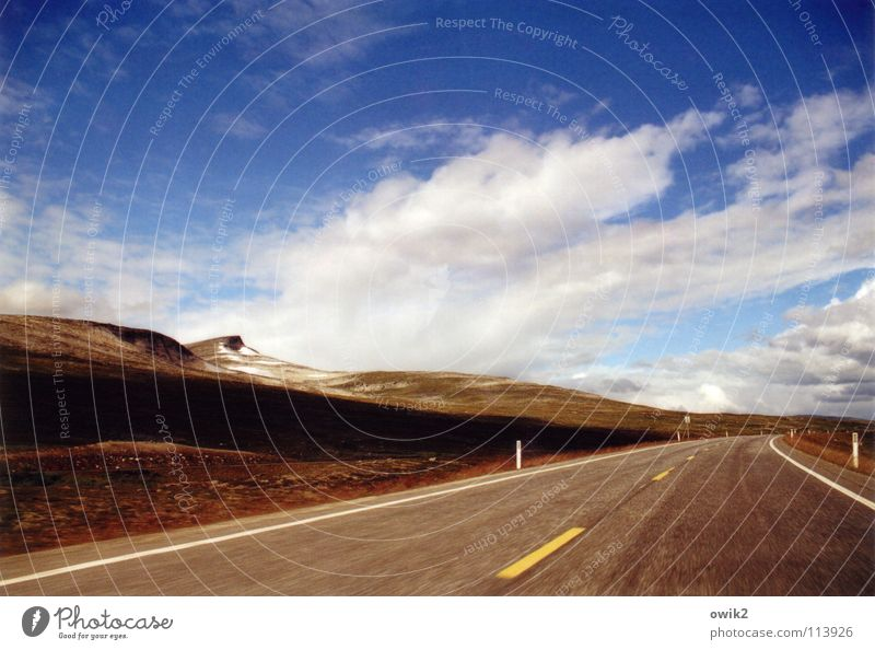 Sky Nature Landscape Clouds Far-off places Mountain Street Above Horizon Signs and labeling Open Speed Logistics Driving Traffic infrastructure Curve