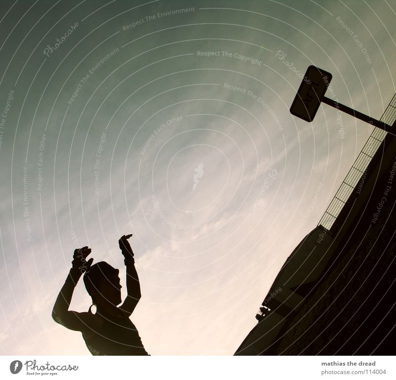 FLIP AROUND! 4 Dark Black Silhouette Upper body Man Threat Diagonal Back-light Green Clouds Vail Joy Street sign what is he doing? Shadow Stupid sign off