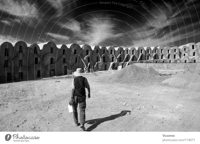 High Noon Tunisia Siesta Set Construction site Cirrus Clouds Loneliness Man Working man Midday Loam Architecture Africa Ghorfa high noon Star Wars Shadow