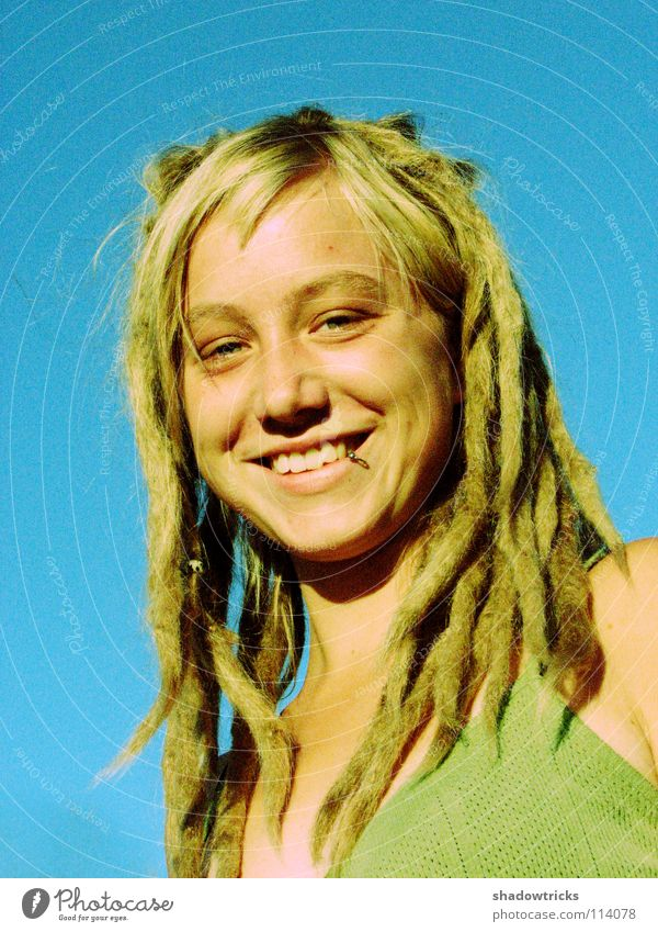 smile Woman Dreadlocks Blonde Hair and hairstyles Reggae Style Alternative Portrait photograph Whim Good Happiness Human being Laughter funky Sky Eyes Mouth