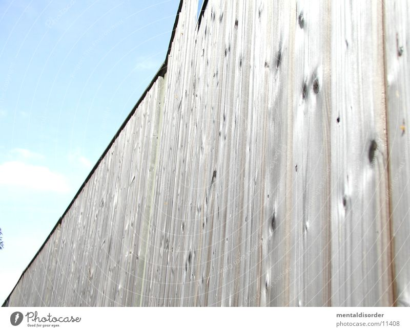 Sky Calm Clouds Wood Wall (barrier) Architecture Branch Highway Wooden board Pallid Loud Behind Crash Knothole