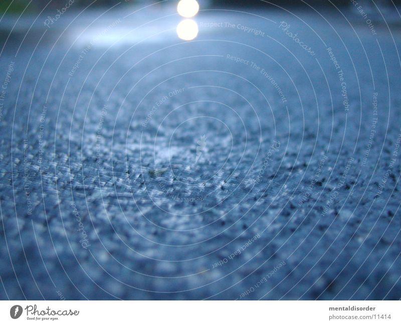 wet asphalt Asphalt Traffic lane Wet Light Transport Street Blue Water Focal point Floodlight Lie Horn Rain
