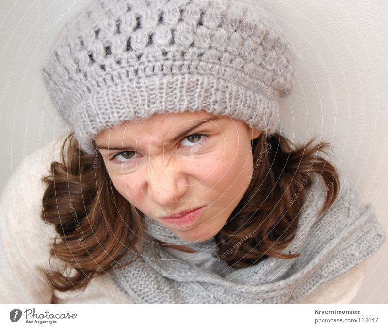 Girl Beautiful Anger Brunette Aggravation Long-haired Scarf Partially visible Strand of hair Negative Childish Dismissive Dark-haired Woolen hat Bad mood