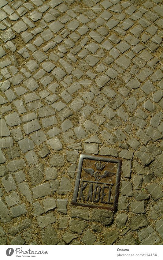 Street Stone Signs and labeling Places Cable Floor covering Wing Rust Traffic infrastructure Cobblestones Iron Paving stone Friedrichshain Granite Berlin