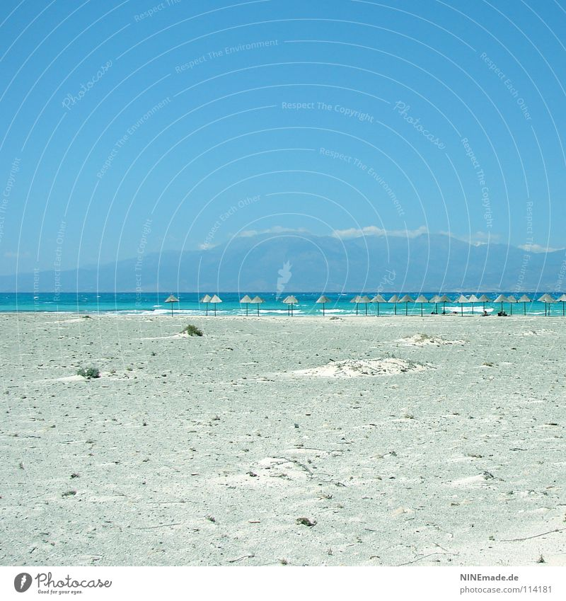 HOLIDAYS Beach Summer Physics Vacation & Travel Sunshade Wood Sky blue Crete Loneliness Empty Calm Vacation mood Greece Waves Ocean Horizon Sandy beach