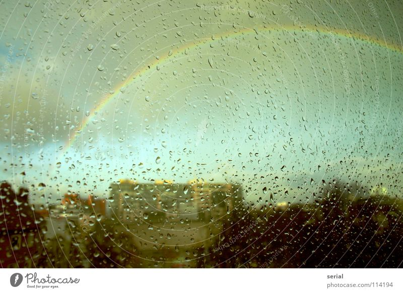rain bow drops Rain Window Window pane Rainbow Dark Exceptional Clouds Town Nature Sky Beautiful Transience Glass Colour raindrops supernatural colours