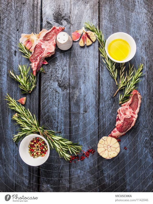 Raw lamb chops with oil, rosemary and garlic Food Fish Herbs and spices Cooking oil Nutrition Dinner Banquet Organic produce Diet Bowl Style Design