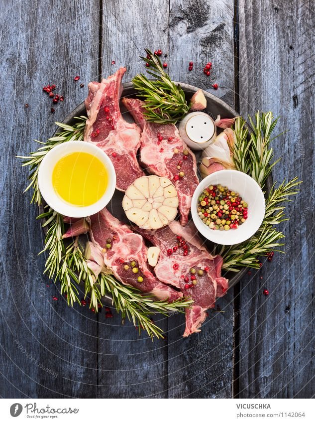 Raw lamb cutlet with oil, rosemary and spices Food Meat Nutrition Dinner Banquet Organic produce Diet Style Design Healthy Eating Life Table Kitchen
