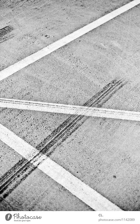 tracks Transport Traffic infrastructure Road traffic Motoring Street Lanes & trails Parking lot Line Asphalt Ground Skidmark Safety Black & white photo