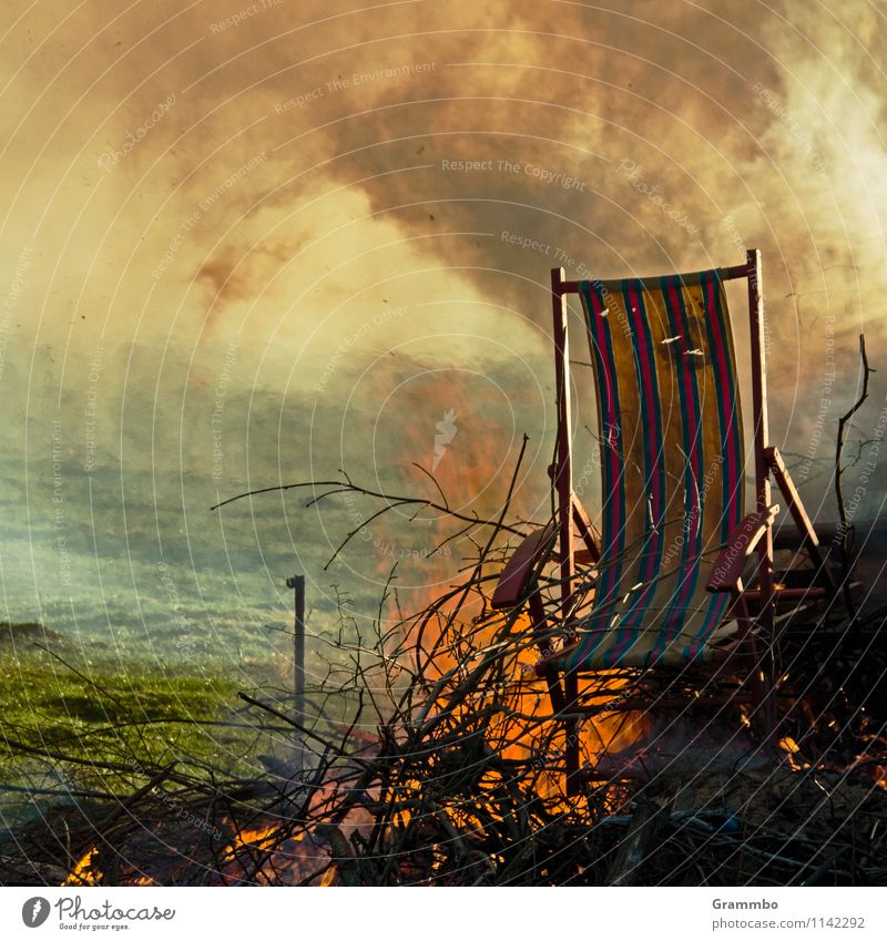fire stool Wood Old Brown Green Orange Deckchair Fire Fireplace Flame Smoke Exhaust gas Easter fire Glittering Colour photo Subdued colour Exterior shot