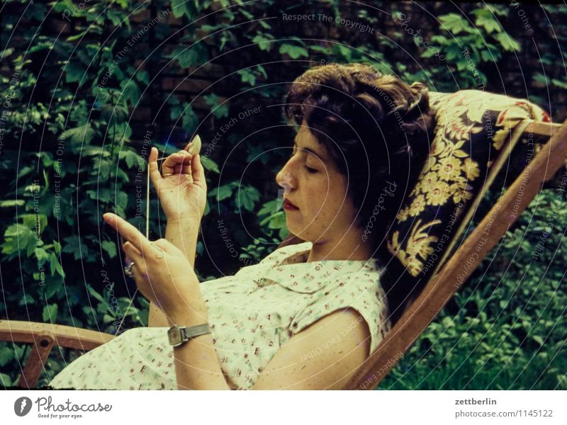 Human being Woman Green Summer Relaxation Hand Calm Face Garden Fashion Lie Leisure and hobbies Copy Space Fingers Couch Past