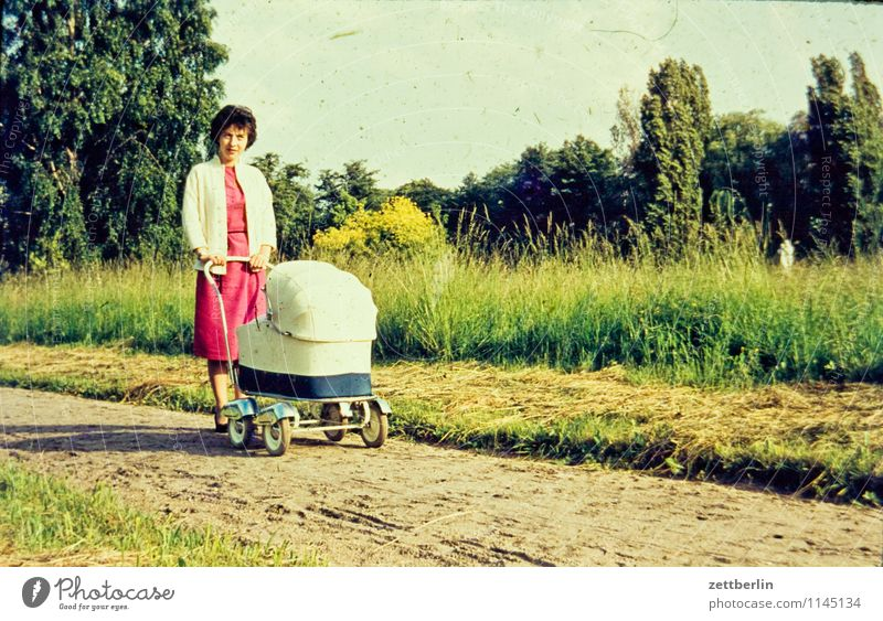 Mother with pram Family & Relations Family outing Family planning Domestic happiness Related Past Child Infancy Childhood memory Memory The fifties Sixties