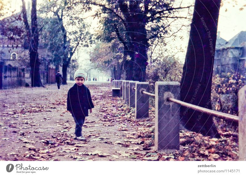 Child in autumn Boy (child) Face Joy Good mood Family & Relations Related Hiking Family outing Domestic happiness Vacation & Travel Past The fifties Sixties