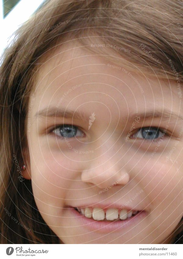 Child Girl Blue Eyes Laughter Hair and hairstyles Mouth Nose Teeth Lips