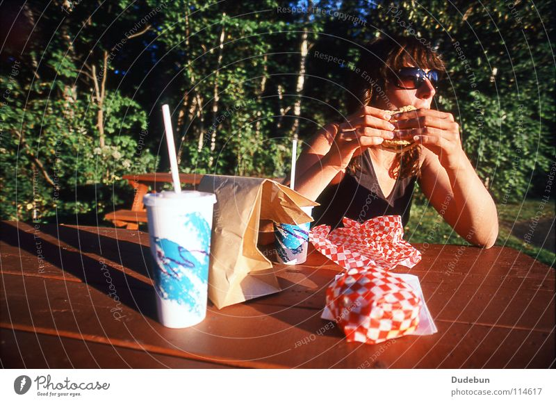The Tasty Treat Colour photo Exterior shot Copy Space top Day Shadow Sunlight Wide angle Upper body Looking away Hamburger Nutrition Fast food Cold drink Summer