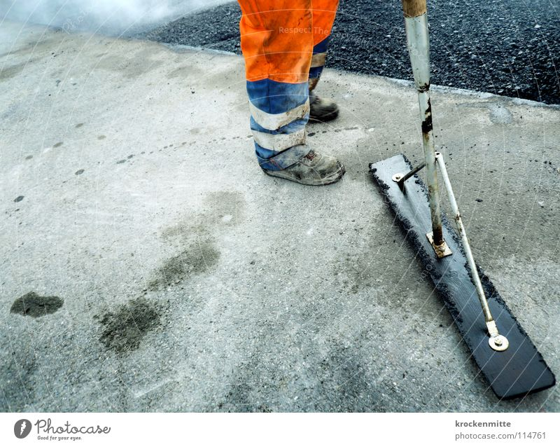 Man Street Work and employment Footwear Orange Asphalt Hot Smoke Traffic infrastructure Working man Tar Workwear Road construction