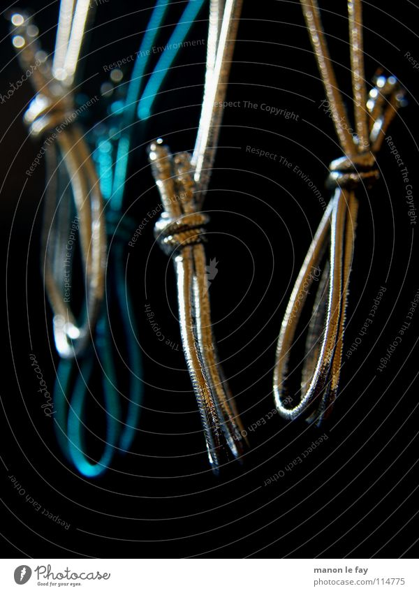After the feast is before the feast Black Hang Hang up Bond Macro (Extreme close-up) Close-up Blue Silver String Elastic band Object photography Dark background