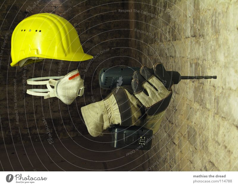 Masked Work and employment Construction worker Helmet Construction site helmet Yellow Warning colour Face mask Breath Gloves Work gloves Drill Cellar Dark
