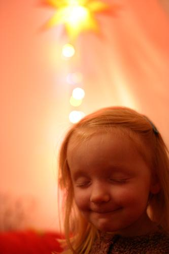 I ffüns' mia... Child Girl Desire Dream Moody Christmas & Advent Winter December Fairy lights Closed eyes Blonde Think Christmas star Yellow Red Pink