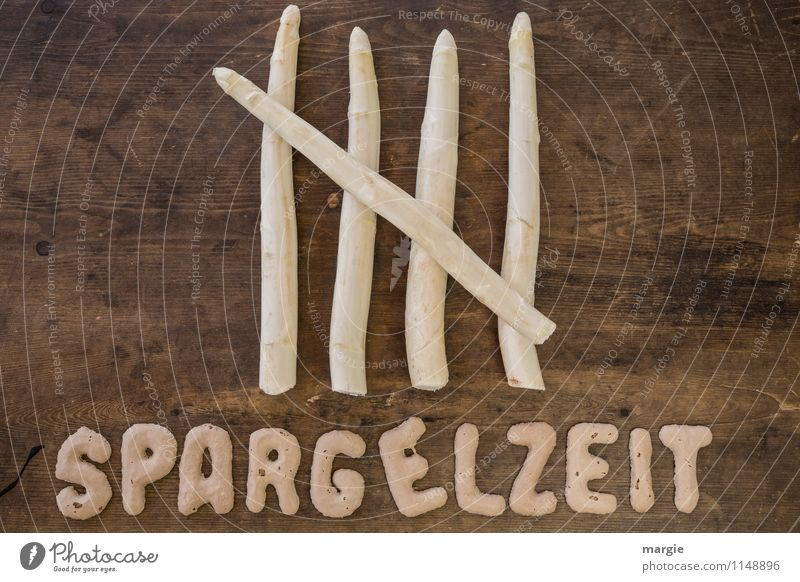 The letters SPARGELZEIT on a rustic board with 5 asparagus spears Food Vegetable Lettuce Salad Asparagus Asparagus season Asparagus head Asparagus spears