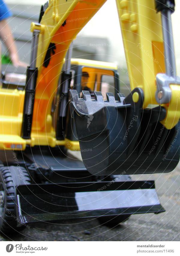 Man Joy Black Yellow Playing Sand Toys Things Statue Build Excavator Bulldozer