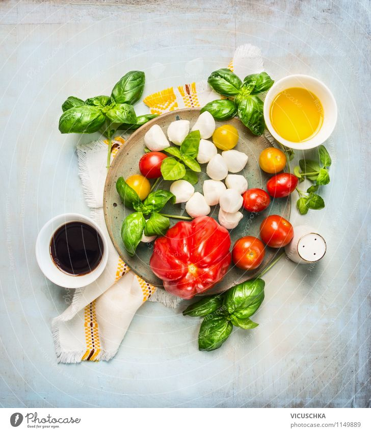 Salad of tomatoes and mozzarella with balsamic dressing Food Dairy Products Vegetable Herbs and spices Cooking oil Nutrition Lunch Banquet Organic produce