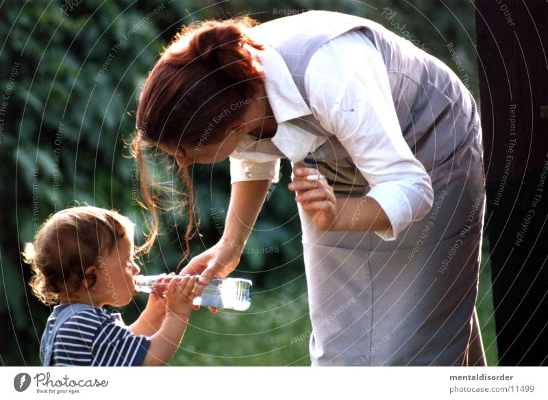 helping hand Mother Woman Son Love Boy (child) Bottle Water in the country